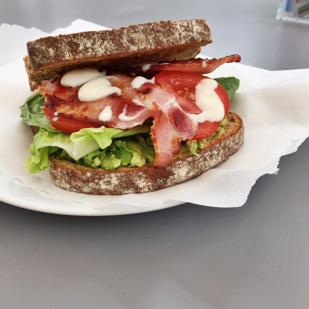 BLT on rye bread with avocado, bacon, lettuce, tomato and mayonnaise
