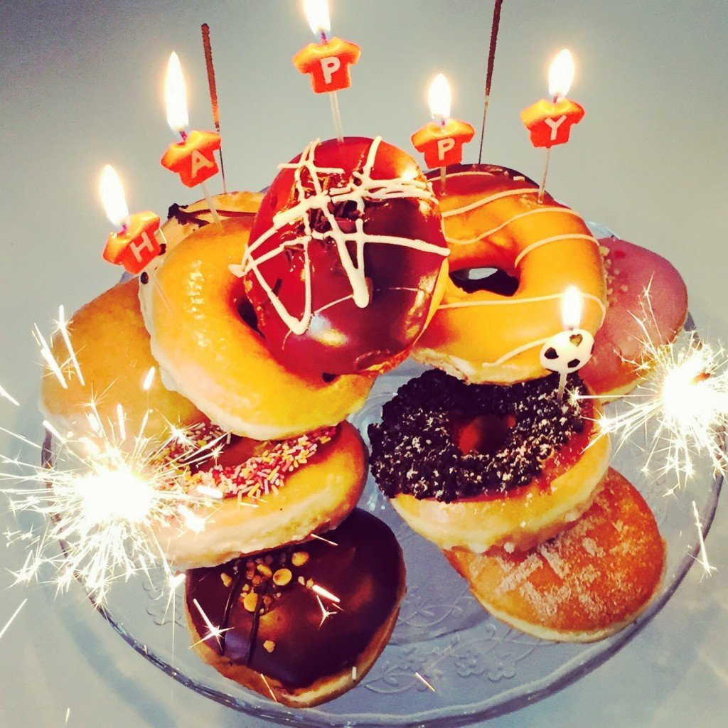 birthday cake made from pile of Krispy Creme doughnuts.