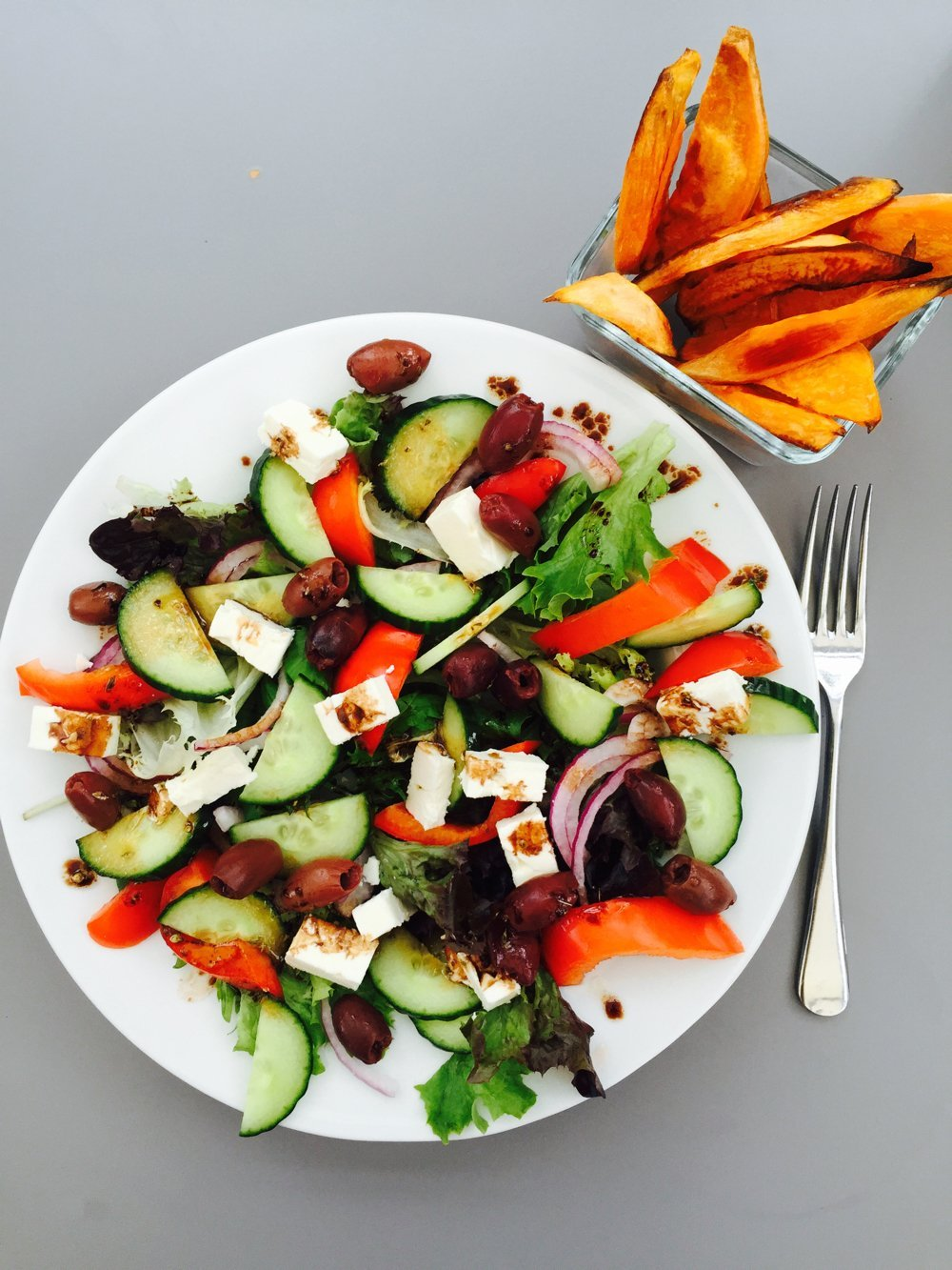 Awesome Greek salad with sweet potato wedges