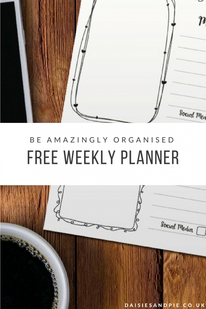Black and white printed weekly planner alongside white samsung phone and cup of black coffee on a wooden table