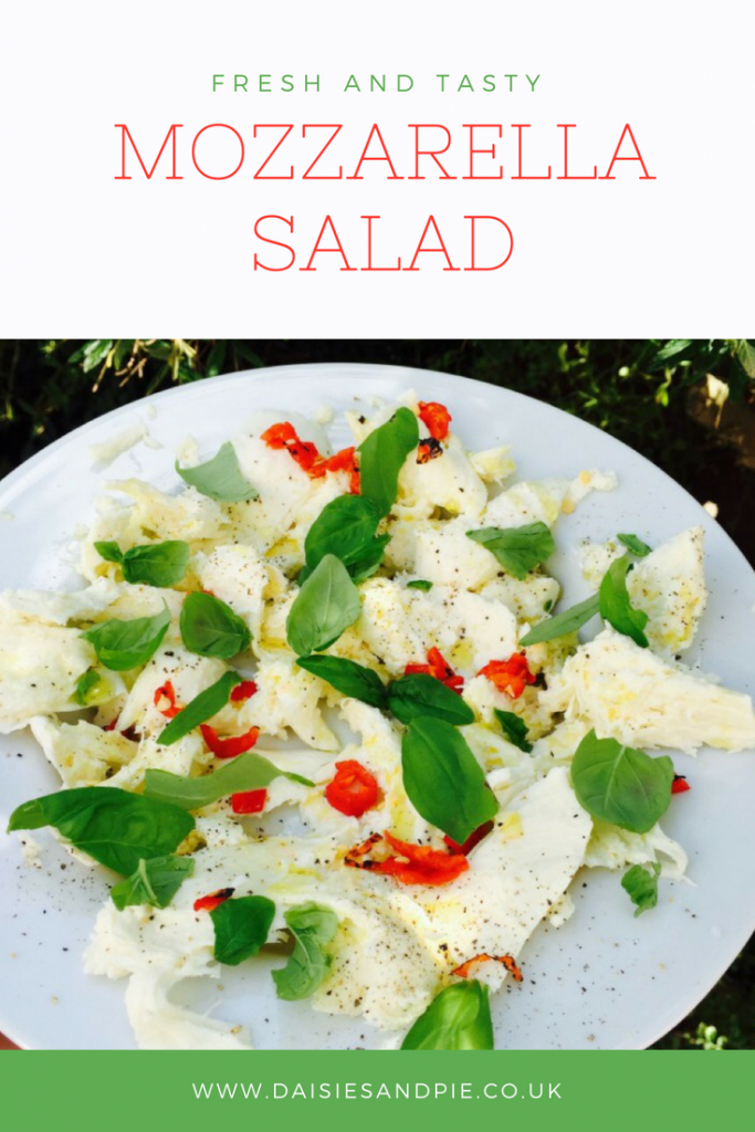 "plateful of homemade Italian mozzarella salad with fresh basil and red chilli. Text overlay saying ""fresh and tasty mozzarella salad - www.daisiesandpie.co.uk"""