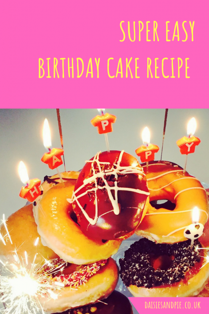 "birthday cake made from pile of Krispy Kreme doughnuts. Text overlay saying ""super easy birthday cake"""