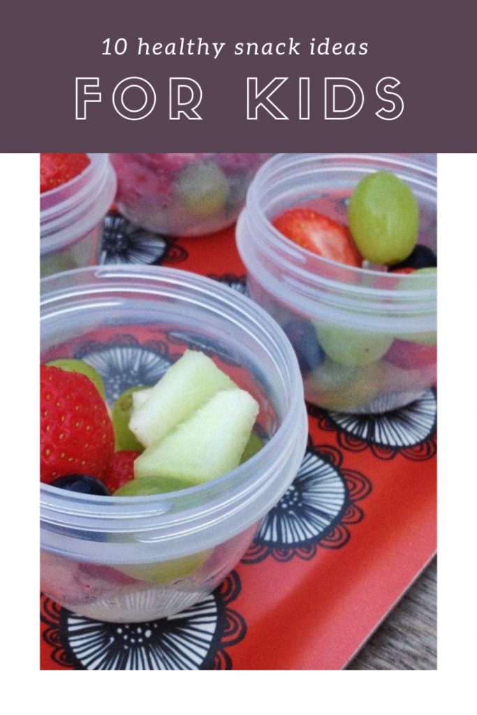 """tray of snack pots with fruit salad. Text overlay """"10 healthy snack ideas for kids"""""""