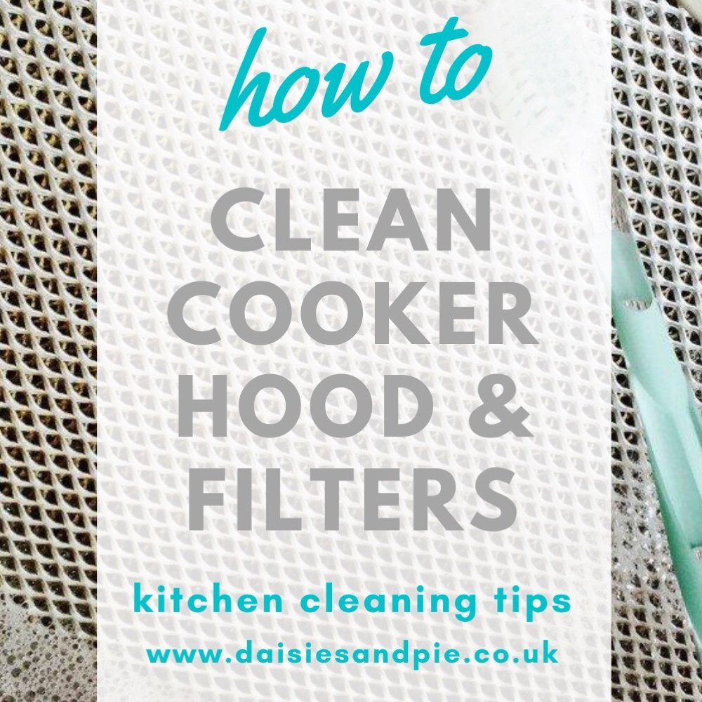 stainless steel cooker hood filters being cleaned with hot soapy water and a soft bristle brush