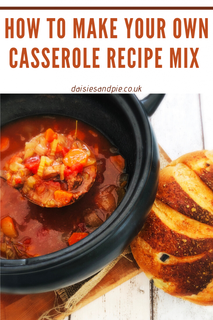slow cooker pan filled with homemade beef and vegetable casserole - rustic loaf next to the pan ready for pulling off and dipping in
