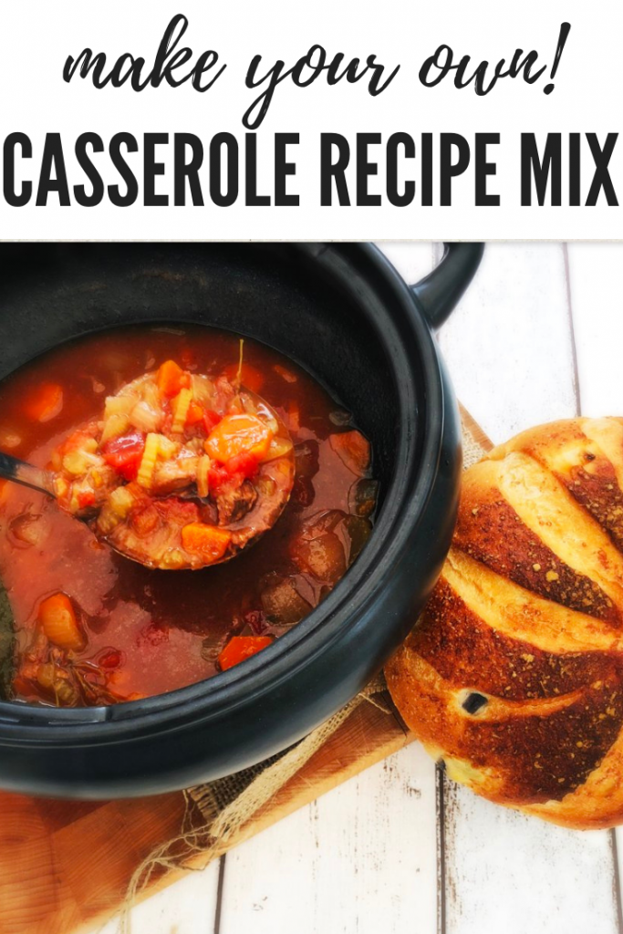 rustic beef and vegetable casserole in a black slow cooker pan alongside a rustic loaf of bread