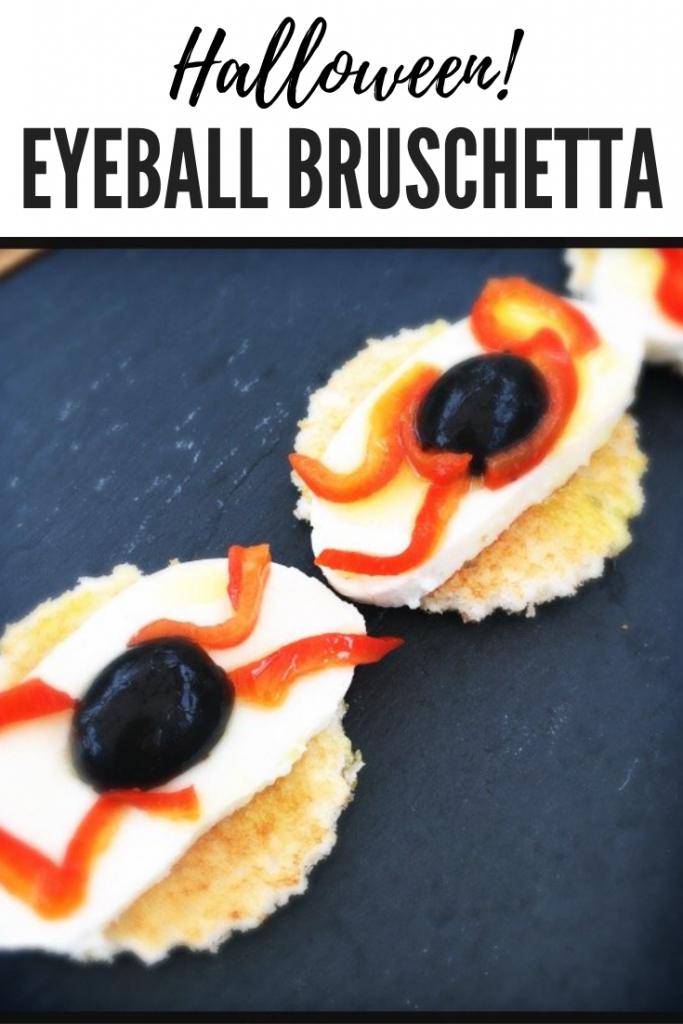 "Halloween appetizer Italian bruschetta with mozzarella, olives and peppers arranged in the shape of an eye ball. Text overlay ""Halloween eyeball bruschetta"""