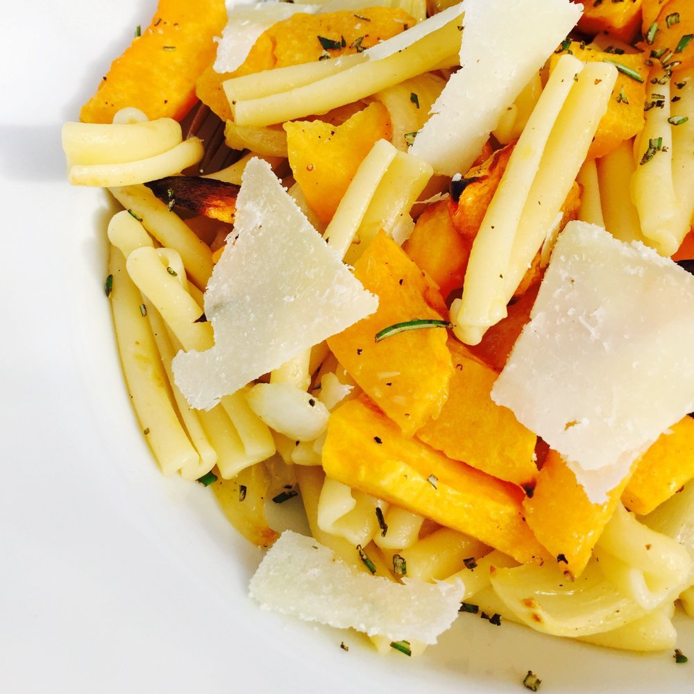 plate of pumpkin pasta with parmesan shavings.