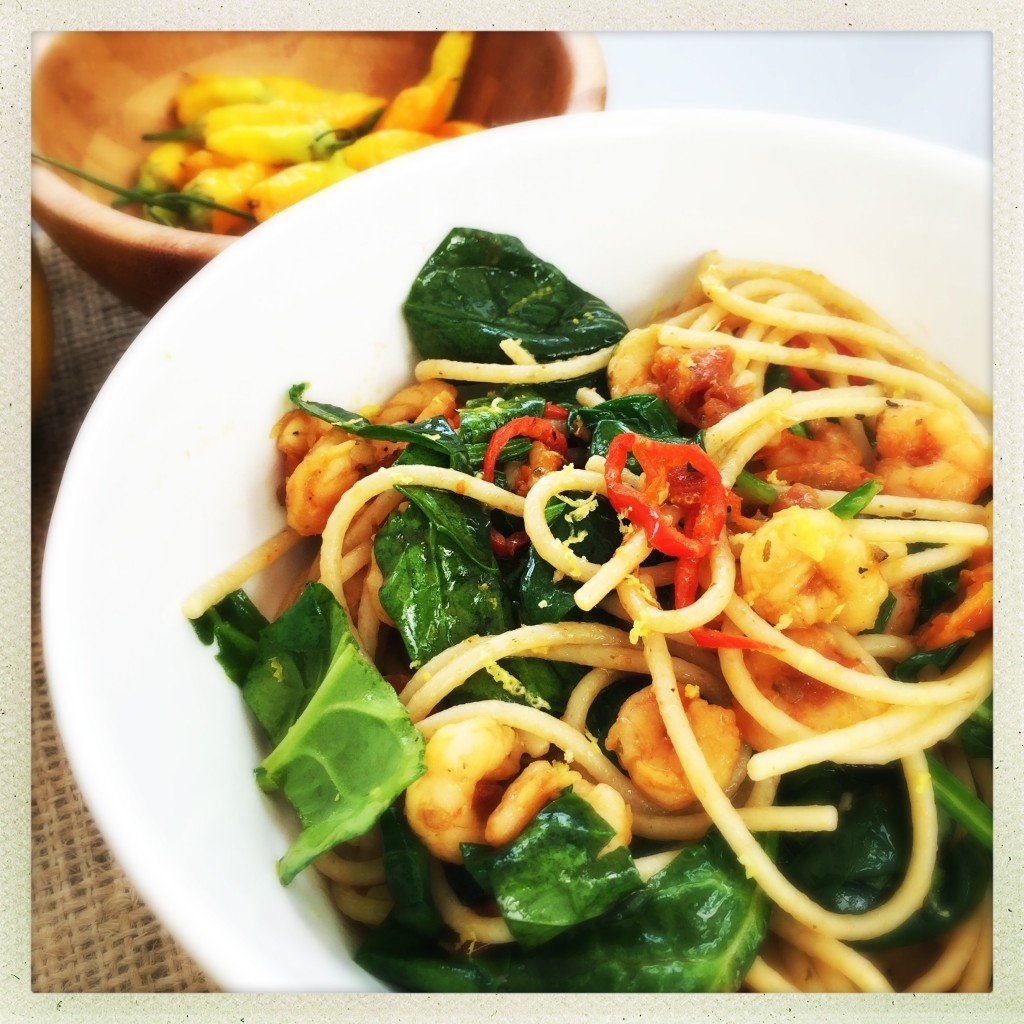bowlful of spicy prawn spaghetti with spinach and chillies