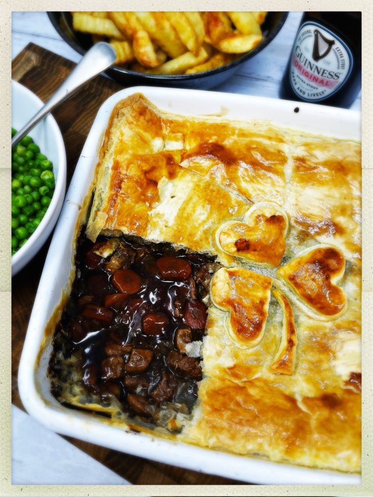 steak and guinness pie with a shamrock on the pastry. Served with crinkle cut chips and a bowl of buttered peas with jug of gravy and bottle of guinness