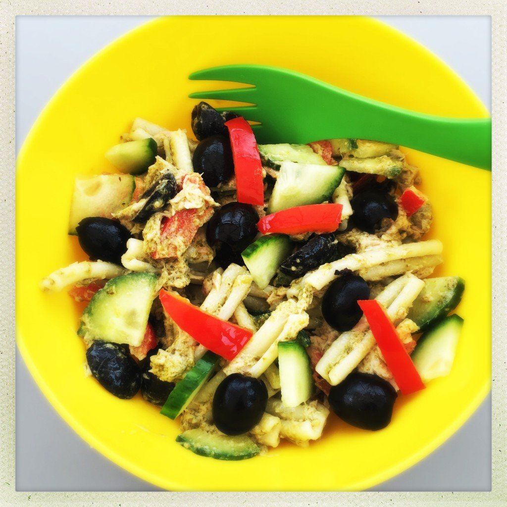 homemade tuna pasta salad with canned tuna, cucumbers, olives, peppers and pesto.