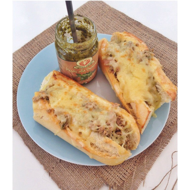 tuna cheese melt on crusty baguettes made using canned tuna and pesto
