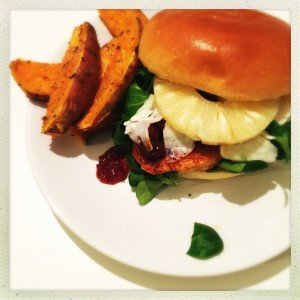 chicken fillet burger topped with halloumi, chilli jam and pineapple on brioche rolls with sweet potato wedges.