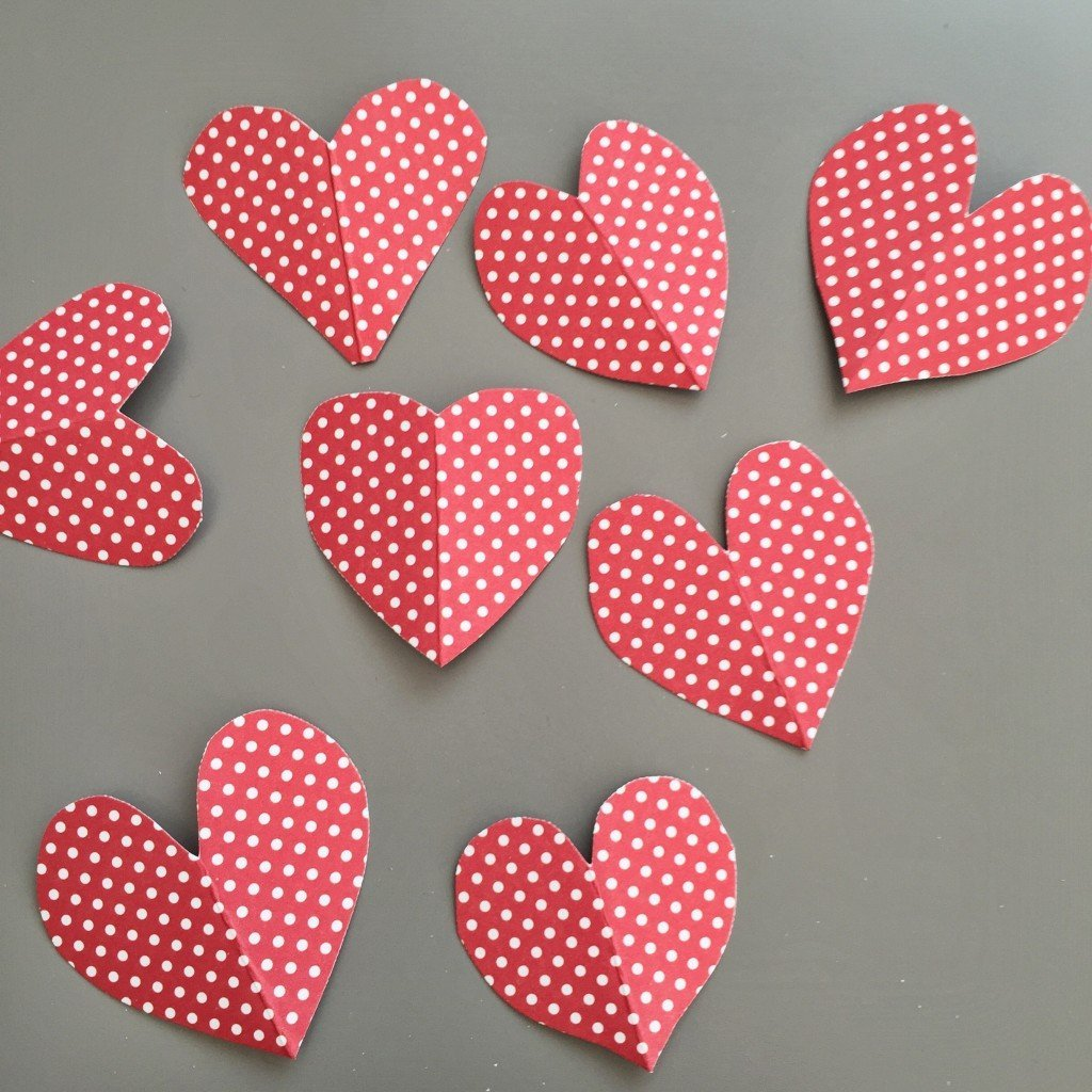 lots of paper love hearts cut from pretty paper