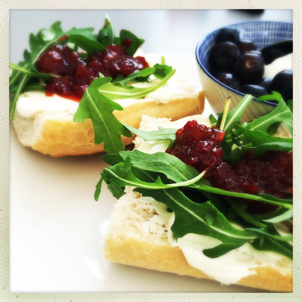 cream cheese and chilli jam with rocket leaves on french baguette