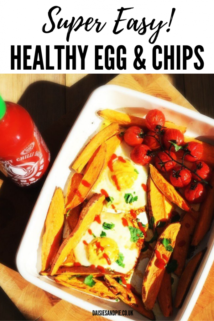 """enamel roasting tin filled with oven baked egg and chips with sweet potato wedges and roasted baby vine tomatoes. Text overlay reads """"super easy healthy egg and chips"""""""