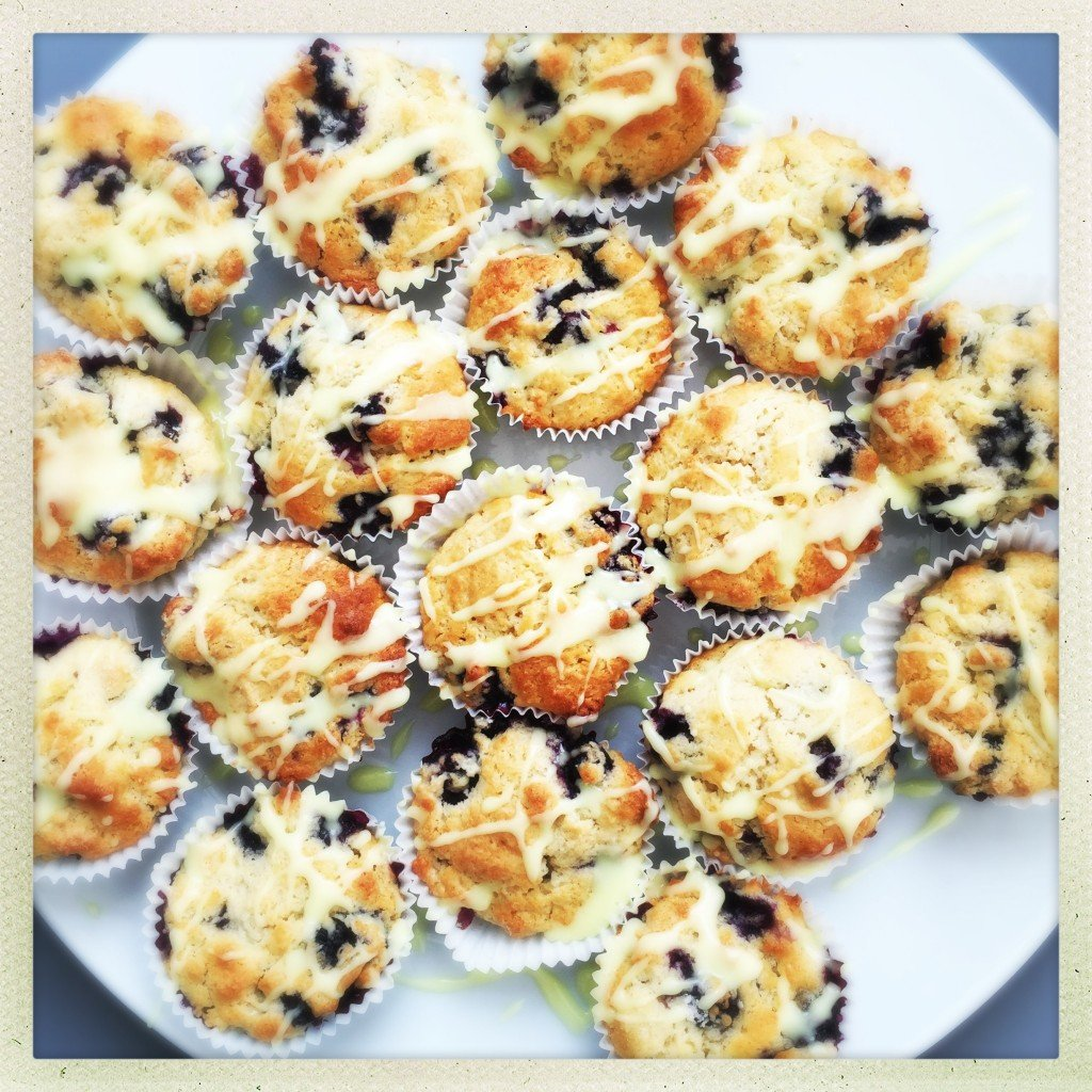platter of mini blueberry muffins with lemon drizzle icing