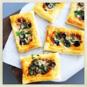 white paper with pizza puff tarts on top