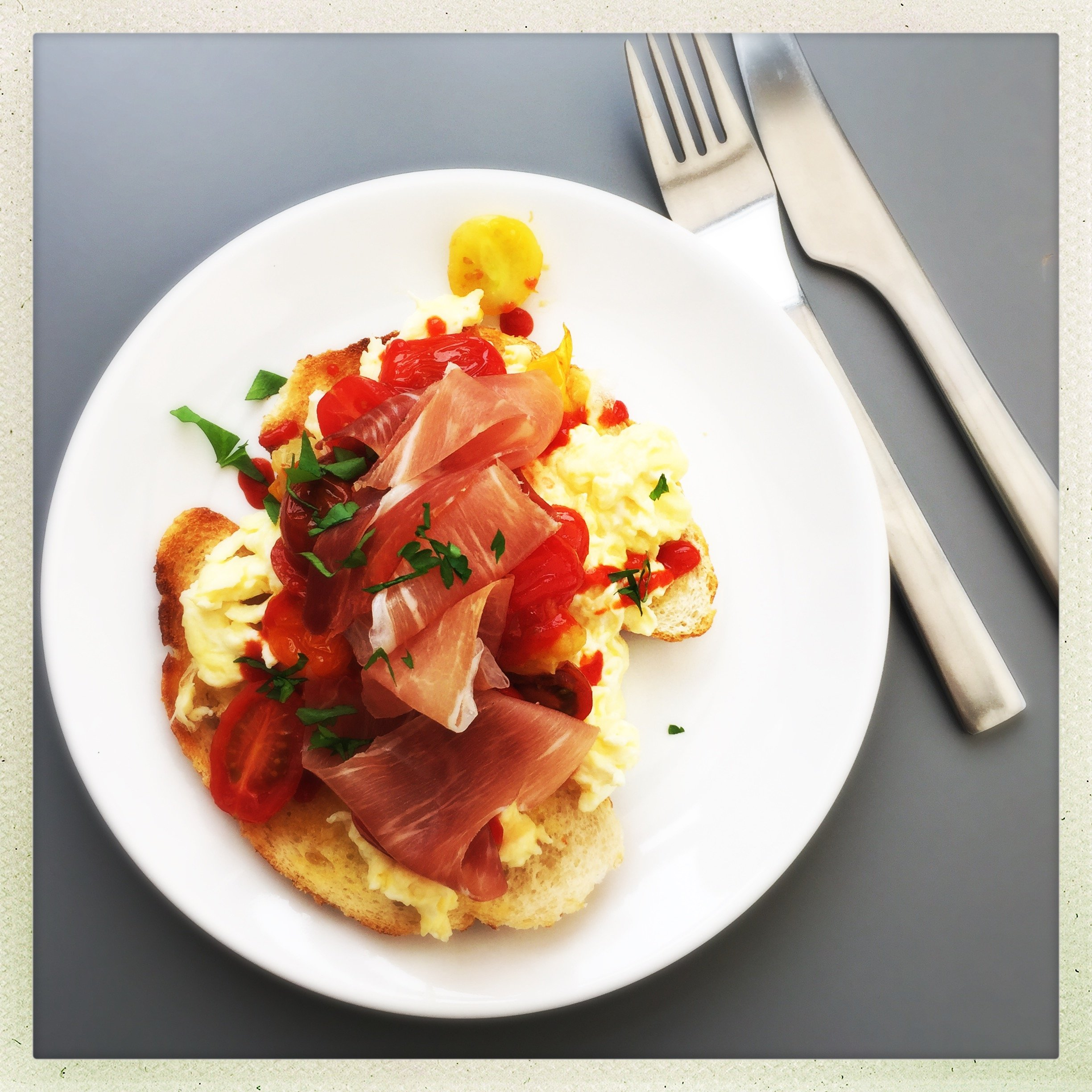 Beautiful brunch with eggs and parma ham
