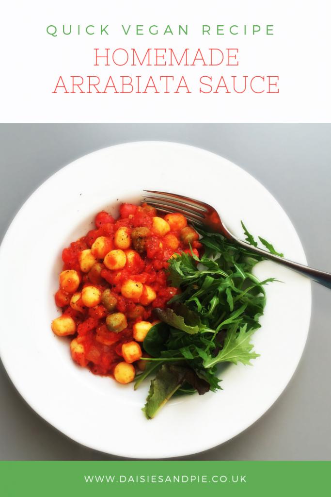 """homemade arrabiata sauce wit gnocchi and a rocket salad. Text overlay saying """"quick vegan recipe - homemade arribiata sauce"""""""