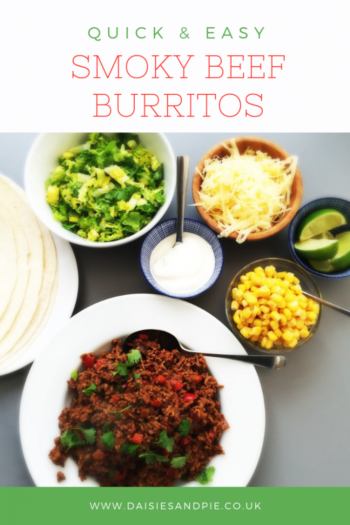 """bowl of spicy beef burrito meat alongside bowls of toppings shredded lettuce, grated cheese, soured cream, sweetcorn and lime wedges. Text overlay saying quick and easy smoky beef burritos"""""""