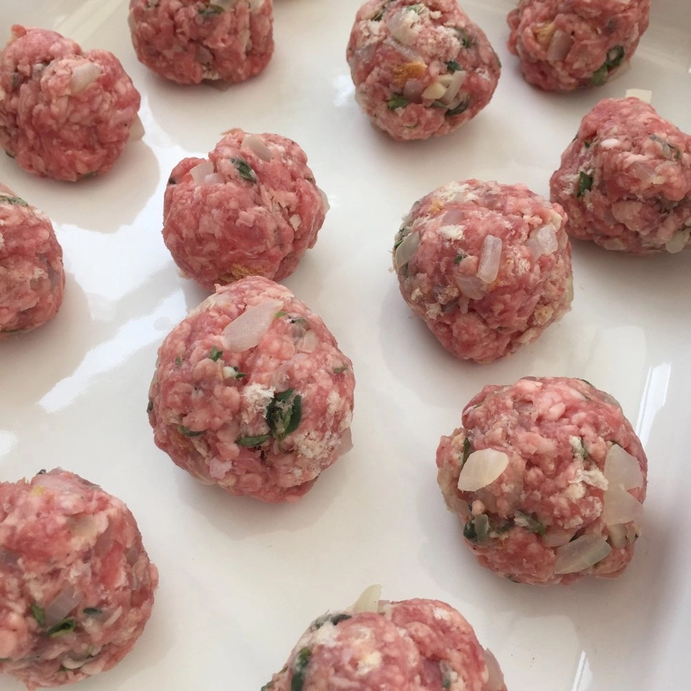 raw lamb meatballs ready to be cooked