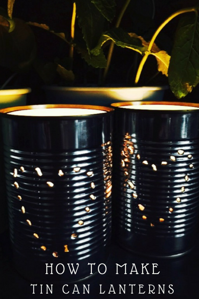 "home made tin can lanterns with hearts on - text overlay saying ""how to make tin can lanterns"""