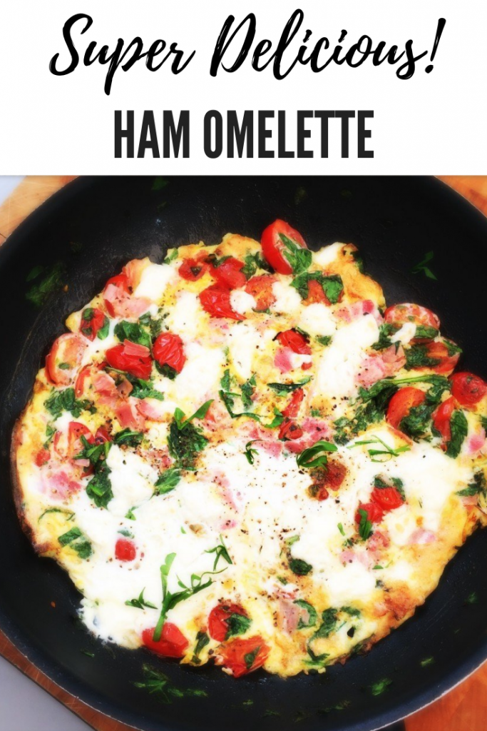 smoked ham omelette, ham and spinach omelette, feta in omelette, quick meal ideas, things to make with eggs, easy family food from daisies and pie. text overlay reads 'super delicious ham omelette'