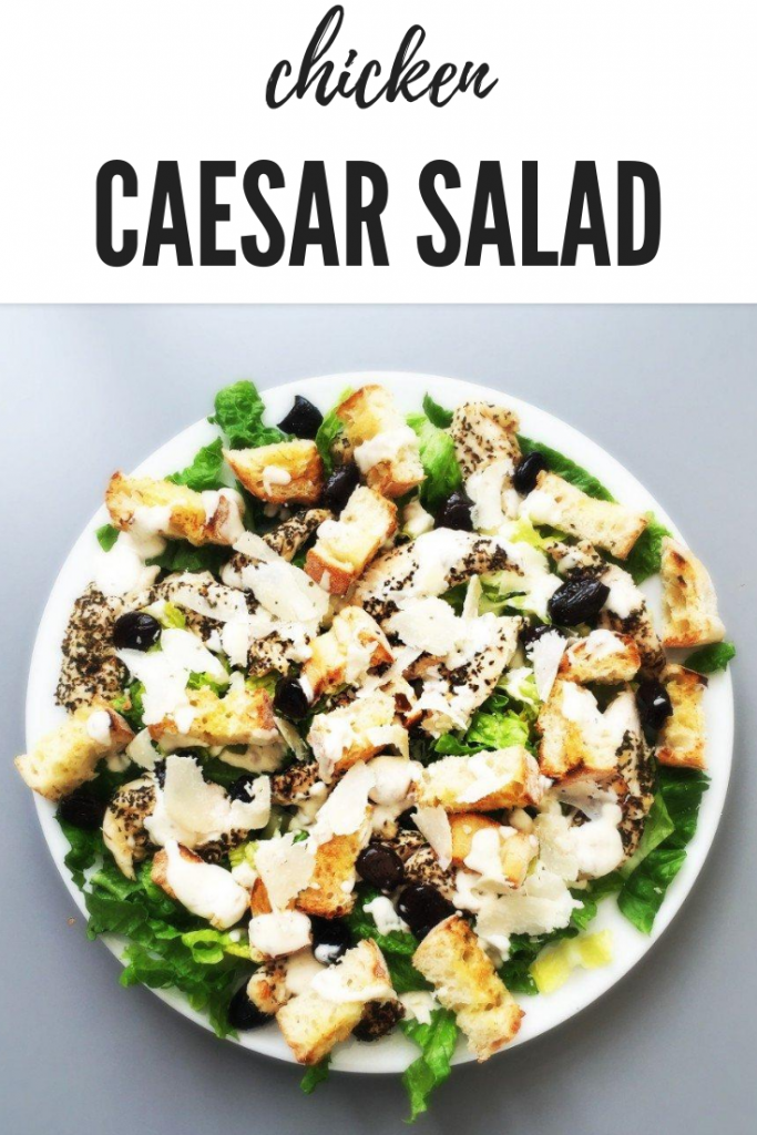 "chicken caesar salad with garlic bruschetta croutons and marinated olives. Text ""chicken caesar salad recipe"""