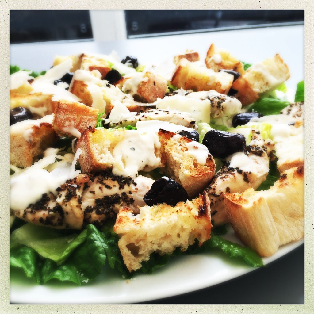 chicken caesar salad with garlic bruschetta croutons and marinated olives