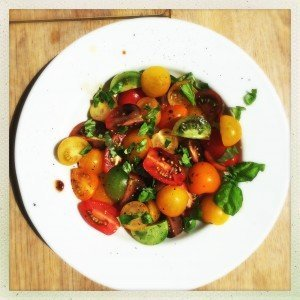 dish of tomato and basil salad with olive oil and balsamic dressing