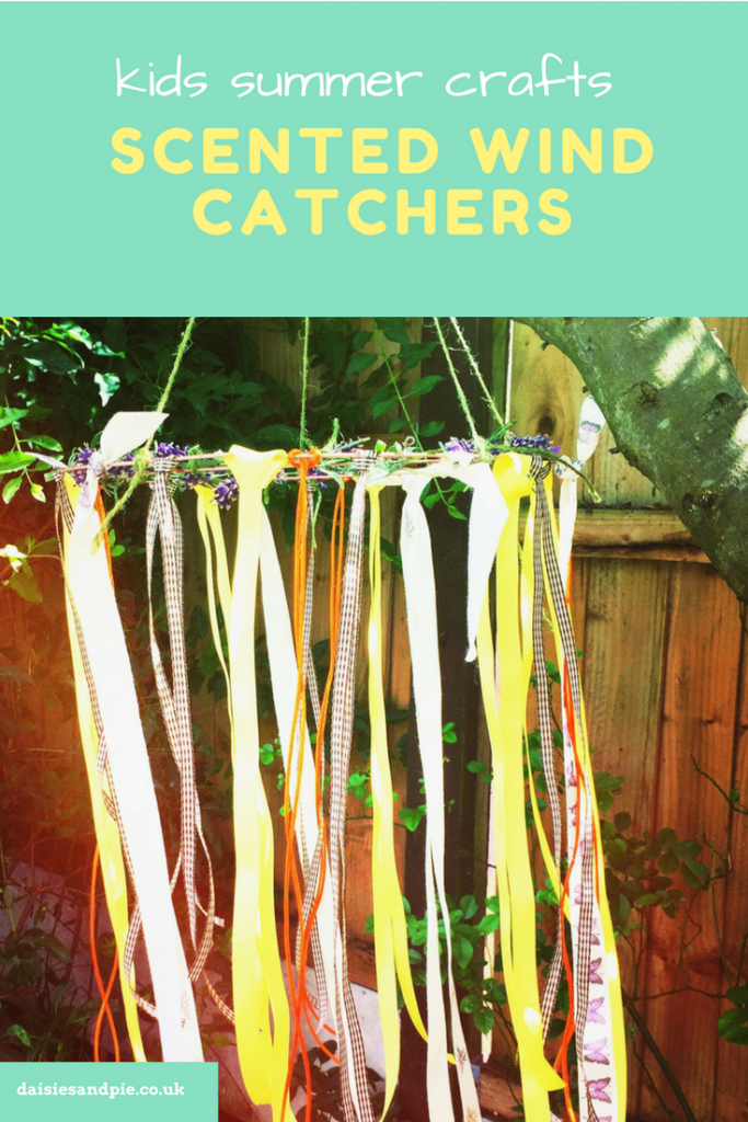 "homemade wind catcher with ribbons and lavender hung from a tree in the garden. Text overlay saying ""summer kids craft - scented wind catchers"""
