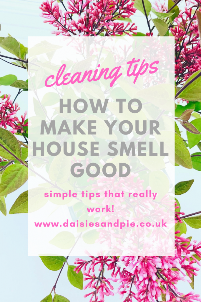 """lilacs in a vase. Text overlay """"cleaning tips - how to make your house smell good - simple tips that really work"""""""