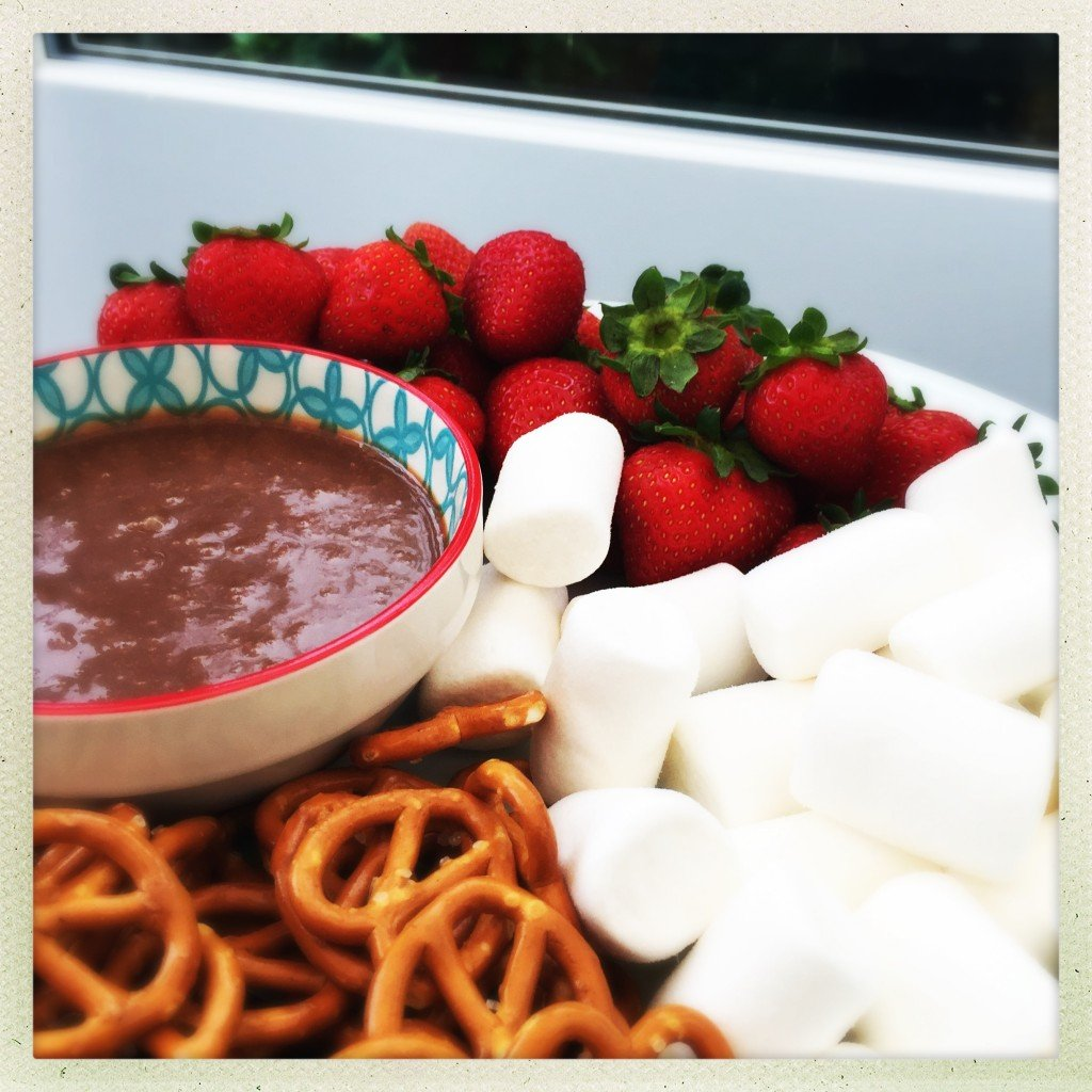 homemade mars bar dip with pretzels, strawberries and marshmallows