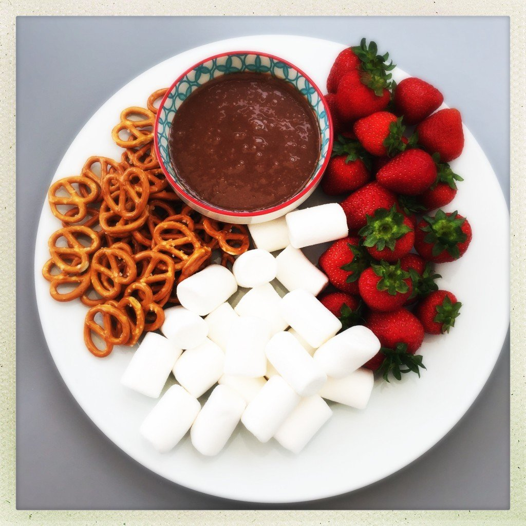 mars bar dip platter served with pretzels, marshmallows and strawberries