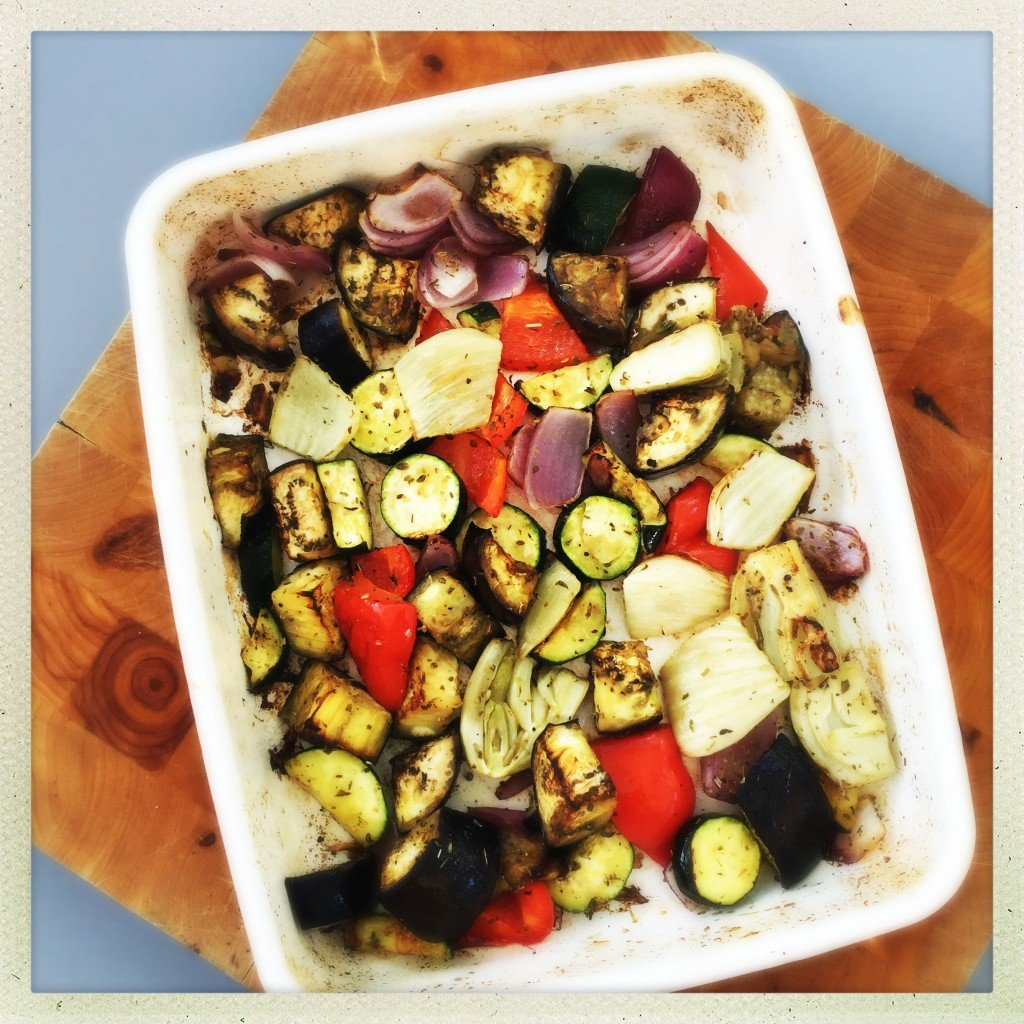 roasting tin filled with roasted Mediterranean vegetables ready to be used in dinner recipes