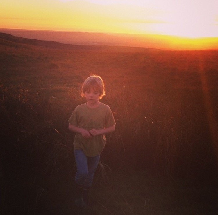 climb a hill and watch the sunset