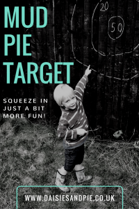black and white photo of young boy stood in front of chalk target shot with mud pie ready to throw
