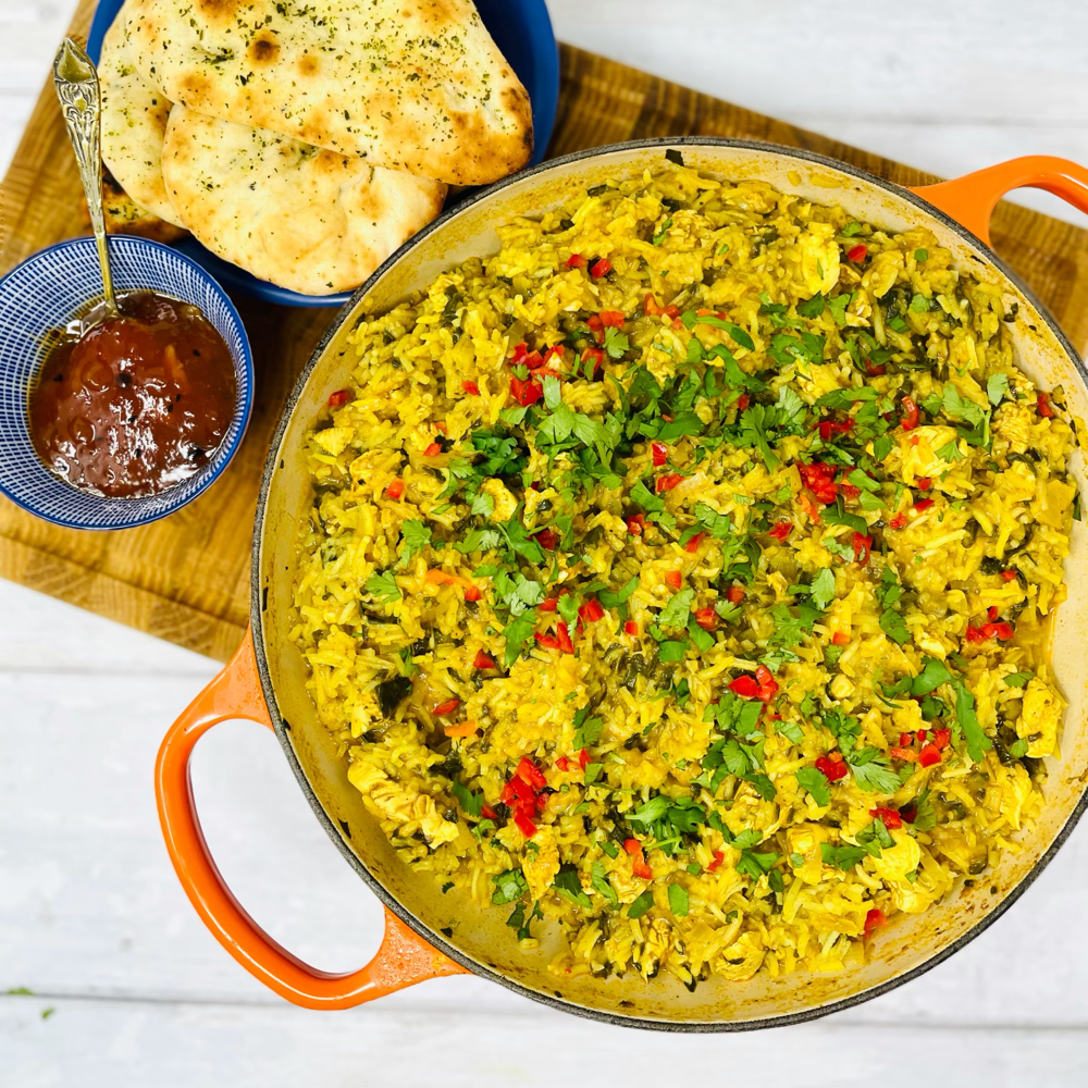 chicken pilaf one pot chicken served with mini garlic naan breads and bowl of mango chutney