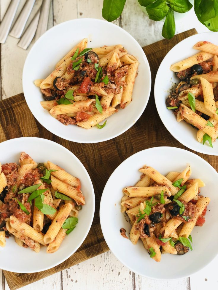 tuna pasta bolognese served in white bowls