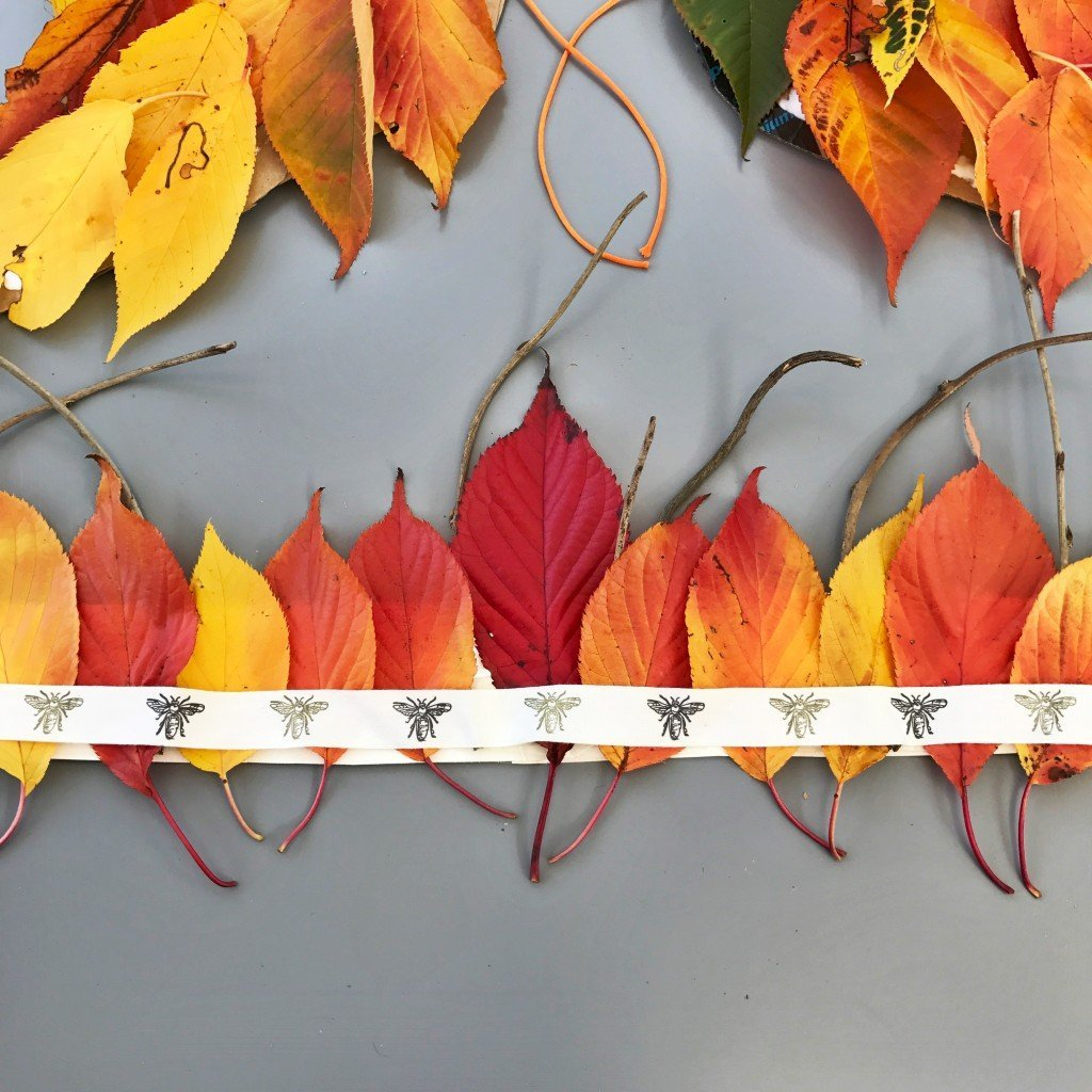 autumn leaf crown made from cardboard, leaves, twigs and ribbon