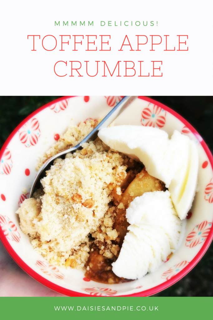 bowl of toffee apple crumble with ice cream. text overlay saying mmmm delicious toffee apple crumble