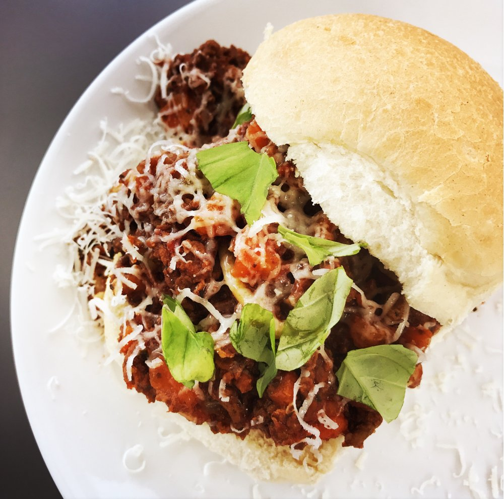 bolognese sloppy joes served in ciabatta rolls with Parmesan cheese