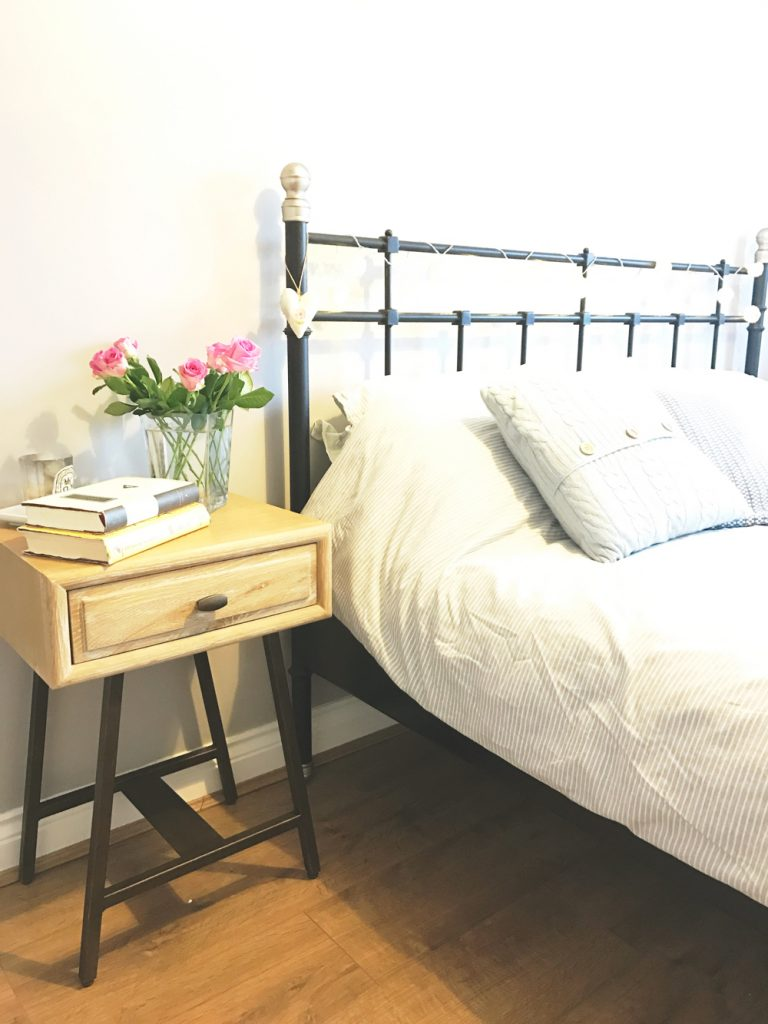 clean bedroom with fresh flowers on the bedside tables