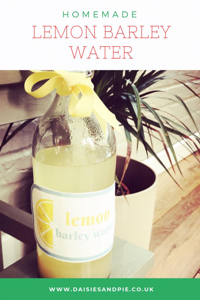 """homemade lemon barley water in a glass bottle. Text """"homemade lemon barley water - daisiesandpie.co.uk"""""""