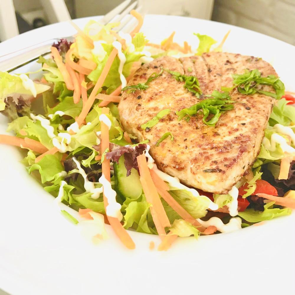 seared cajun tuna on a bed of crunchy sweet salad
