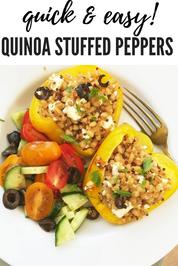 quinoa stuffed bell peppers with feta cheese and herbs served alongside a simple salad with cucumbers, tomatoes and olives