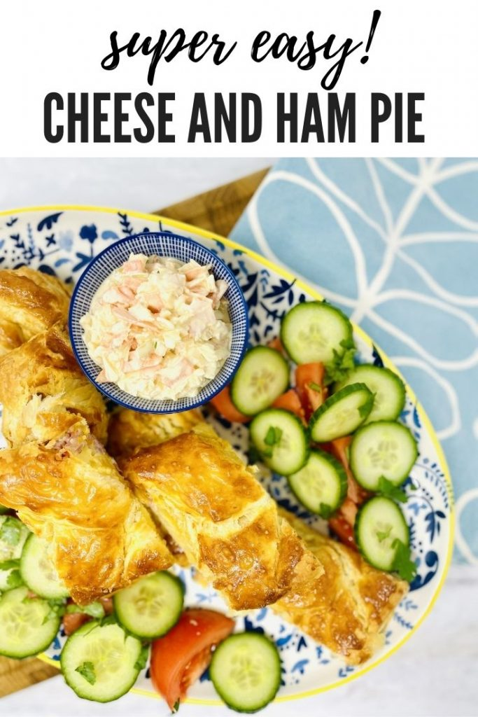 """cheese and ham pie on a blue and white serving platter surrounded by salad and a bowl of coleslaw. Text overlay reads """"super easy cheese and ham pie"""""""