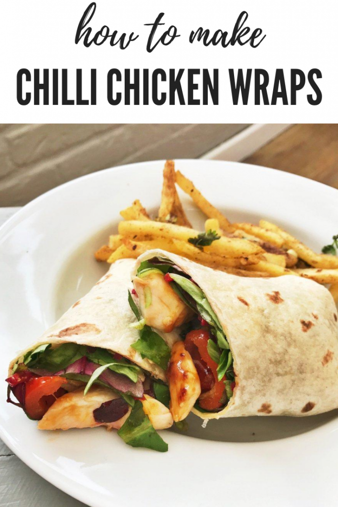 sweet chilli chicken wrap with peppers and salad served with Chinese style chips