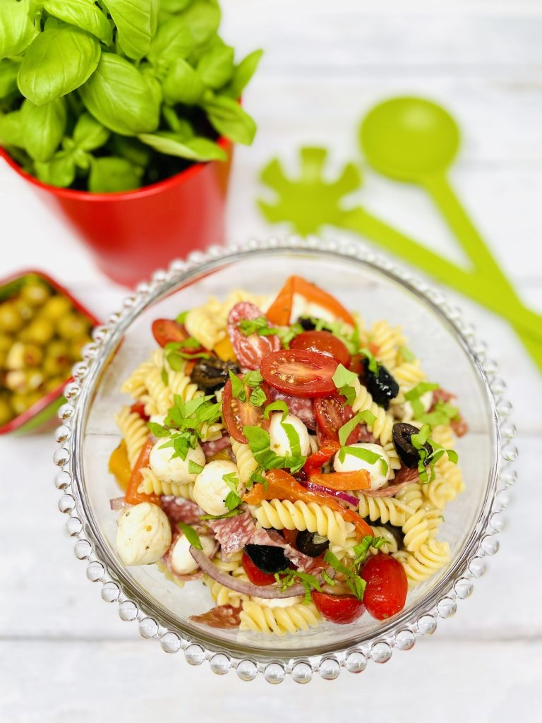 italian pasta salad in a glass salad bowl